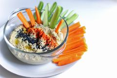 Hummus as an afternoon snack. Hummus is one of the healthiest choices for a snack or lunch stock images