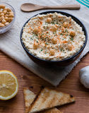 Hummus in black bowl Stock Images