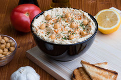Hummus in black bowl Stock Photography