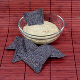 Hummus with Blue Corn Tortilla Chips royalty free stock photography