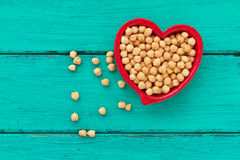 Hummus or chick peas on a vintage wooden background Stock Photography