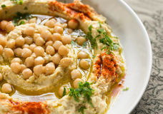 Hummus. With chickpeas on white plate royalty free stock photos