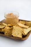Hummus and Chips. Hummus Tomato Basil with Crisp Pita Chips Stock Image