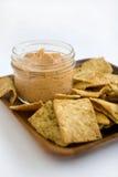 Hummus and Chips. Hummus Tomato Basil with Crisp Pita Chips Royalty Free Stock Photo