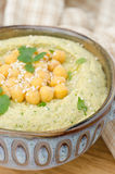 Hummus with cilantro, closeup, selective focus Royalty Free Stock Photography