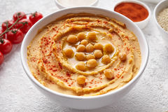 Hummus close up with ingridients, healthy diet natural vegetarian snack protein food. Royalty Free Stock Photography