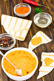 Hummus with Curry, Turmeric, Raw Chickpeas on the Boards Royalty Free Stock Image