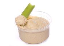 Hummus dietético e aipo do alimento Imagens de Stock