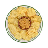Hummus dip in a bowl with potato chips on a plate Stock Photo