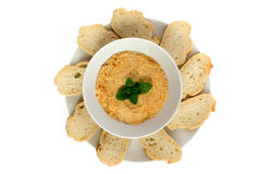 Hummus dip with bread slices Stock Photos