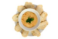 Hummus dip with bread slices Stock Photos