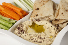 Hummus dip and crudites Stock Images