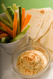 Hummus dip with pita bread and vegetable Stock Photos