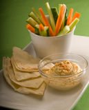 Hummus dip with pita bread and vegetable Stock Images