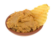 Hummus dip with a potato chip in a bowl Stock Photography