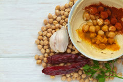 Hummus dish on a vintage wooden background Royalty Free Stock Photo