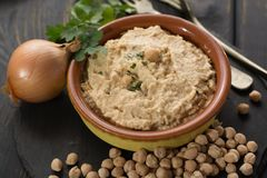 Hummus, everyday meals in Israel made from chickpeas and ingredi. Hummus, dip of spread, everyday meals in Israel made from chickpeas and ingredients that Stock Photography