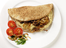 Hummus and fried onion pita sandwich Stock Photography