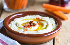 Hummus. Homemade Hummus with carrot sticks royalty free stock image