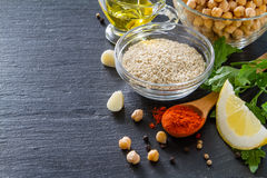 Hummus ingredients. Dark stone background, copy space Royalty Free Stock Image