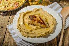Hummus from lenses with chicken steak stock images
