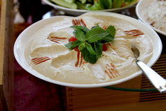 Hummus with mint leaves Royalty Free Stock Image
