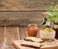 Hummus no pão Foto de Stock