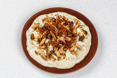 Hummus with olive oil and nuts Stock Images