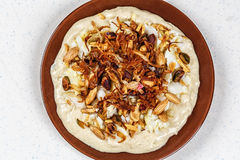 Hummus with olive oil and nuts Royalty Free Stock Photography