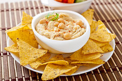 Hummus with olive oil and pita chips Royalty Free Stock Photos