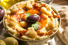 Hummus with olives Stock Photography