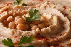 Hummus with paprika and herbs macro. horizontal Stock Photography