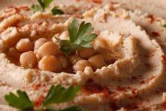 Hummus with paprika and herbs macro. horizontal Stock Photography