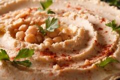 Hummus with paprika and parsley macro. horizontal Royalty Free Stock Photos