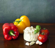 Hummus with peppers, tomatoes and garlic Royalty Free Stock Photography