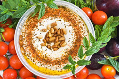 Hummus with pine nuts and  tomato Stock Photos