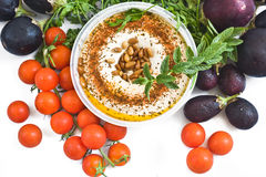 Hummus with pine nuts and tomato royalty free stock photo