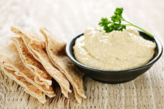 Hummus with pita bread. Bowl of fresh hummus dip with pita bread slices Stock Photography