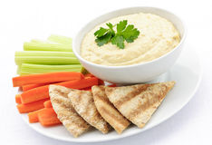 Hummus with pita bread and vegetables stock images