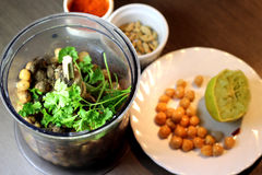 Hummus preparation with parsley and chickpeas Royalty Free Stock Images