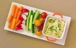 Hummus and raw vegetables stock photos