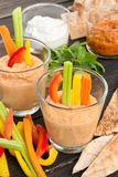 Hummus - healthy and tasty dip. Hummus with red pepper - homemade - traditional Middle Eastern mezze -festive presentation Stock Images