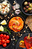 Hummus with roasted peppers and a set of snacks Royalty Free Stock Photos