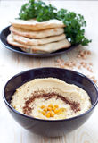 Hummus served with pita bread Stock Image