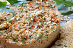 Hummus with sesame seeds and parsley close up stock image