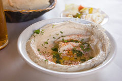 Hummus. On table of a street caf royalty free stock photography