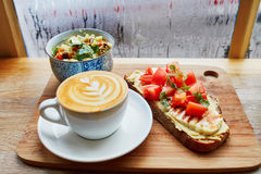 Hummus and tomato sandwich, salad and fresh hot cappuccino coffee Stock Images