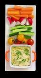 Hummus und rohes Gemüse Stockbild