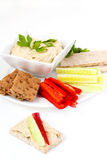 Hummus and vegetables Stock Photos