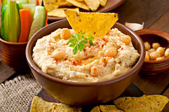 Hummus with vegetables. Healthy homemade hummus with vegetables, olive oil and pita chips Stock Image
